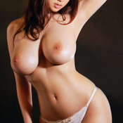 Sexy asian brunette with big tittes photo