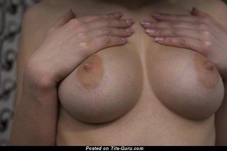 Image. Wonderful girl with medium natural tits image