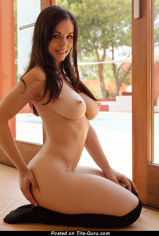 Topless brunette with medium natural boobies image