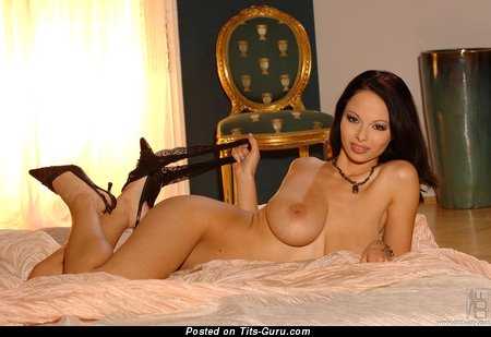 Dominno - nude brunette with big natural boob image