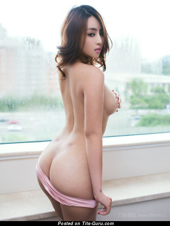 Image. Naked asian brunette with medium natural tittes photo