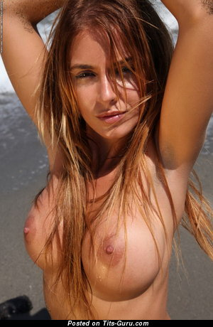 Sexy topless brunette with medium tits and big nipples picture