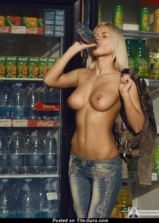Image. Sexy topless blonde with medium natural tittes pic