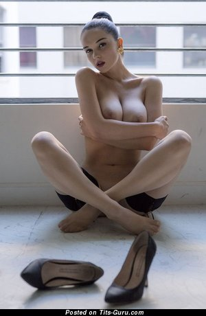 Image. Naked brunette with medium breast photo