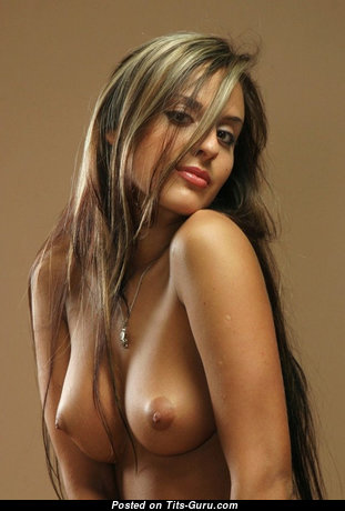 Topless blonde with medium natural boob & big nipples pic