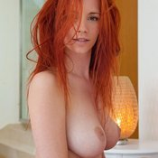 Sexy red hair with natural boobs pic