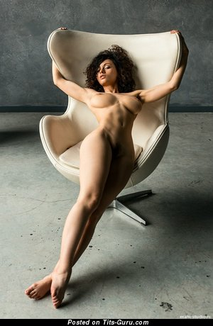 Image. Nude brunette with medium tots photo