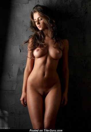 Image. Sexy nude brunette with medium natural breast picture