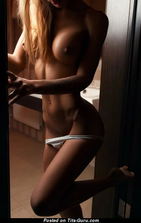 Gorgeous Blonde with Gorgeous Exposed Full Breasts (Xxx Photoshoot)