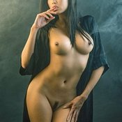 Sexy topless asian with fake boobies pic