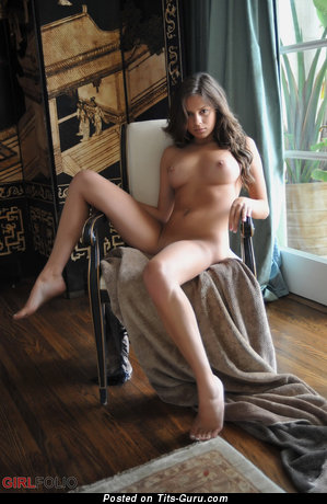 Image. Nina James - naked brunette with medium natural boobies picture