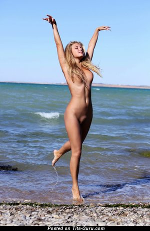 Image. Naked blonde with medium natural boob photo