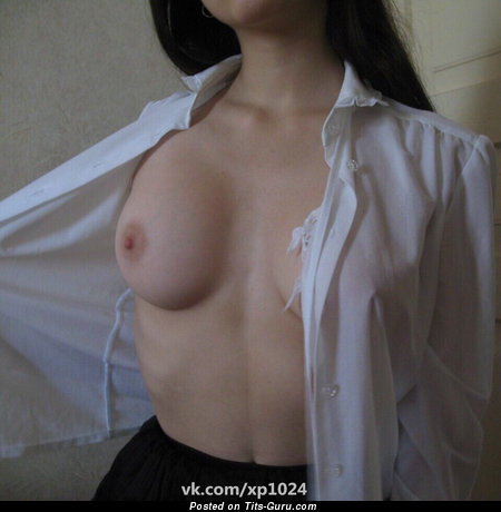 Sexy topless hot girl with medium natural boobies and big nipples photo