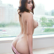 Asian brunette with medium natural boobs image