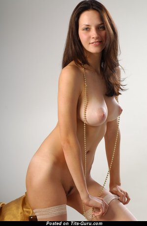 Image. Sexy topless brunette with medium natural tits and big nipples photo