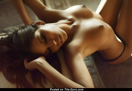 Image. Sexy naked brunette with medium natural tits picture
