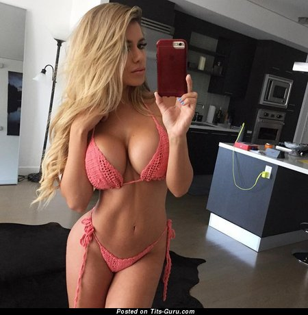 Image. Amateur naked blonde with big fake tits selfie