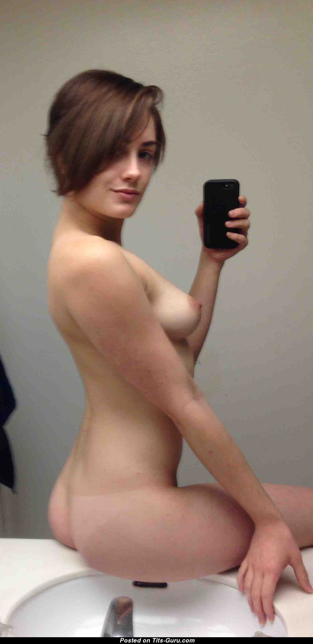 sexy topless amateur hot woman with medium natural boobies selfie