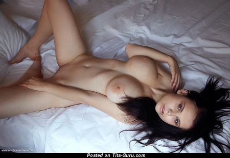 Image. Nude brunette with big breast photo
