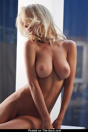 Natali Nemtchinova - topless blonde with medium natural breast and big nipples photo