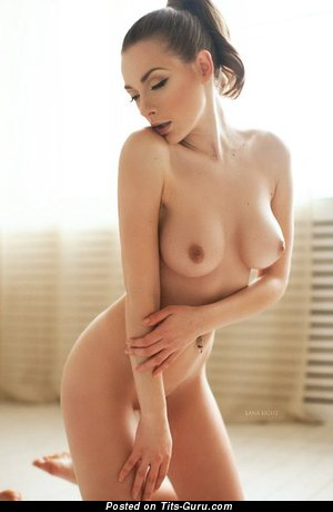 Image. Sexy topless amateur brunette with medium natural boob picture