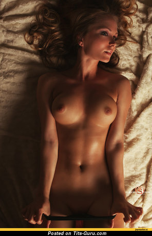 Image. Nude hot female with medium tittes photo