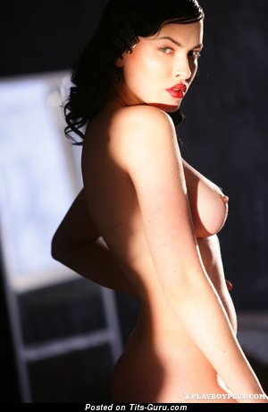 Dasha Astafieva - sexy topless brunette with medium natural boobs and big nipples image