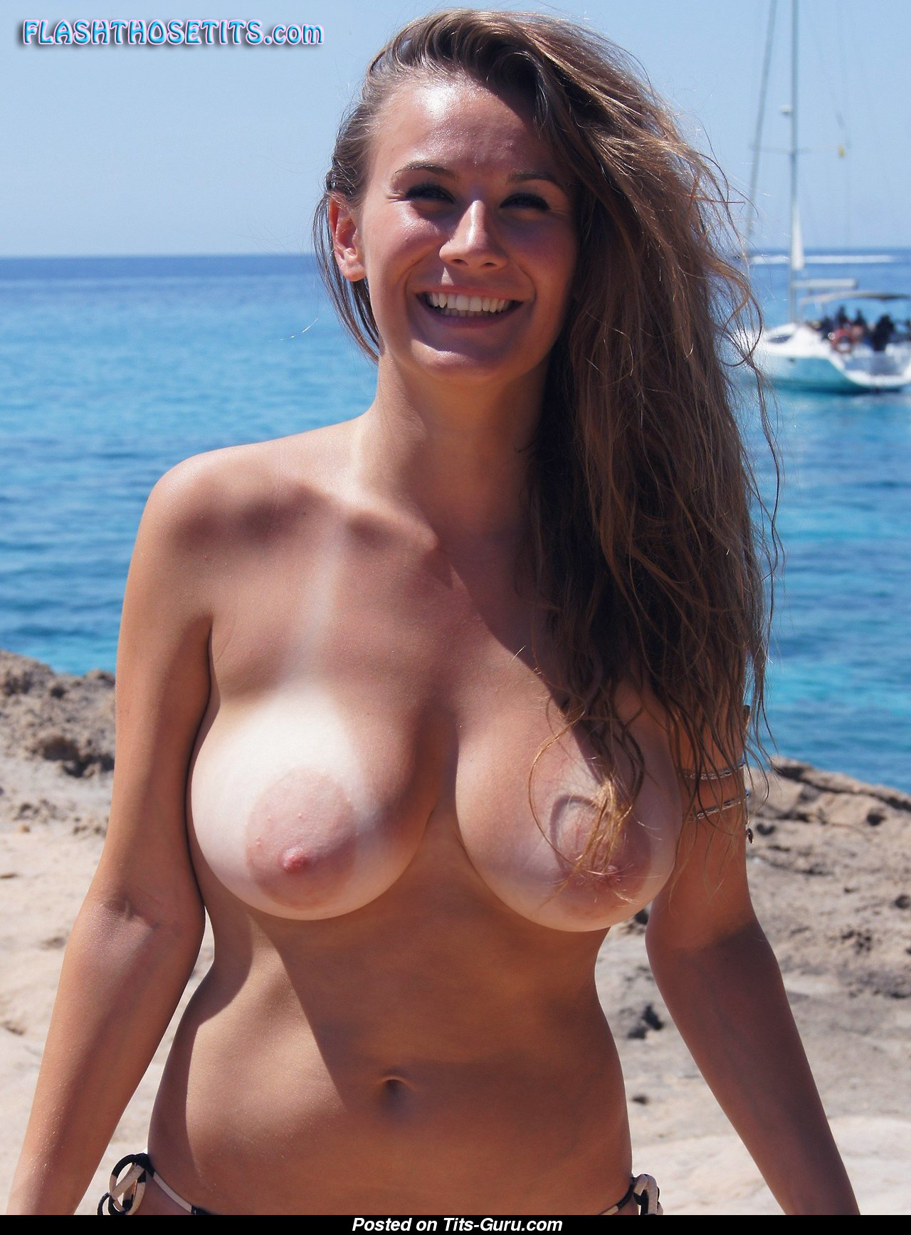 This hot beach babe brunette has such big natural tits