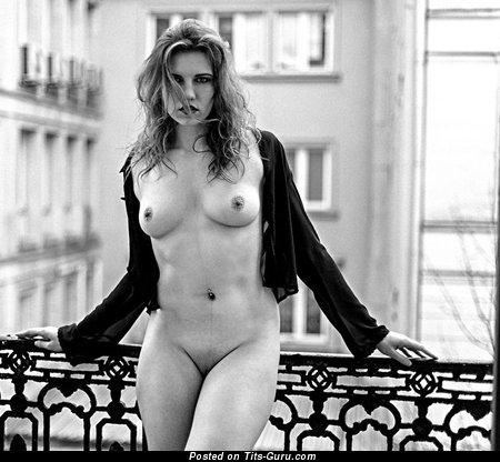 Naked awesome woman with medium natural tittys photo