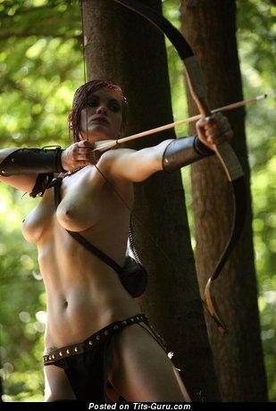 Image. Naked brunette with medium breast photo