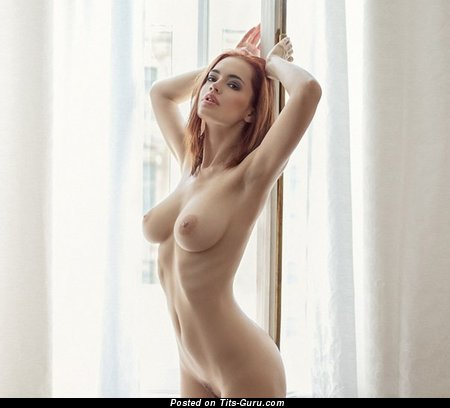 Image. Sexy topless blonde with small natural breast photo