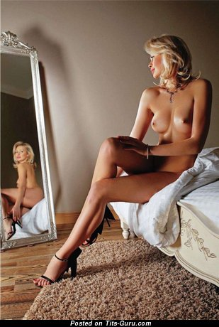 Image. Nude blonde with medium natural tittes picture