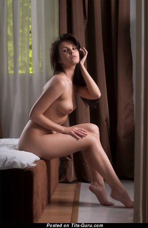 Image. Zelda B - nude brunette with small natural tots picture