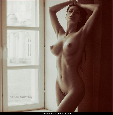 Image. Sexy topless amateur hot female with medium tits photo