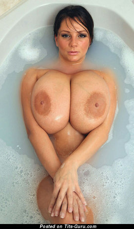 Dazzling Brunette with Charming Exposed Real Gigantic Hooters in the Shower (Sex Image)