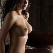 Nude brunette with medium natural tots pic