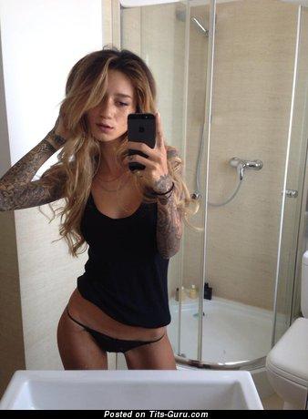 Jenah Yamamoto - naked amazing woman with medium fake tots and tattoo image
