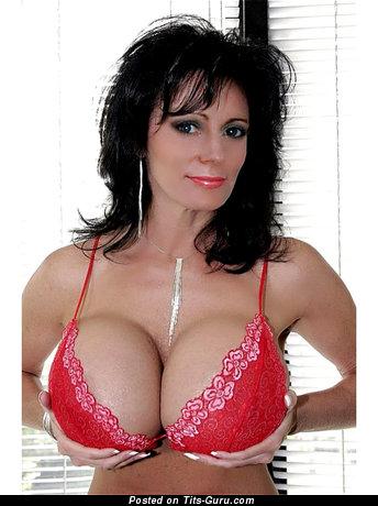 Image. Moyra - nude brunette with big fake boobs image