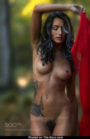 Image. Sexy naked amazing woman with medium natural boobies, tattoo and big nipples pic