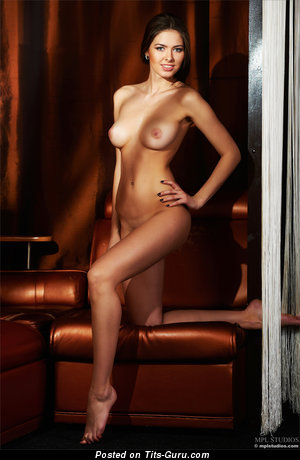 Image. Arianna - naked brunette with medium natural tits photo